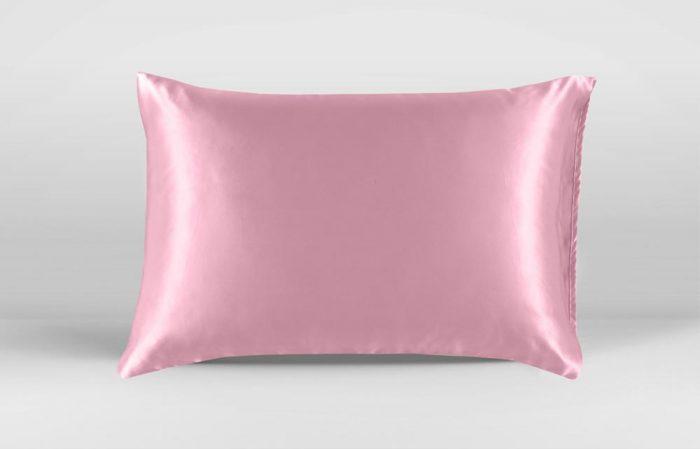Medium wide shot of pillow with pink silk pillowcase