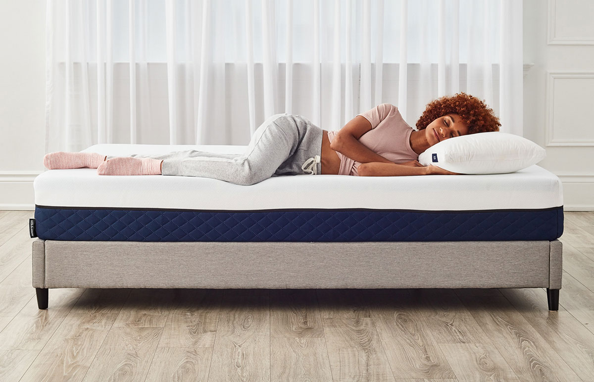 Girl sleeping on Silk & Snow memory foam mattress